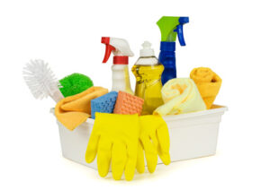 Various household cleaning supplies in a box. Pure white background, soft shadows.